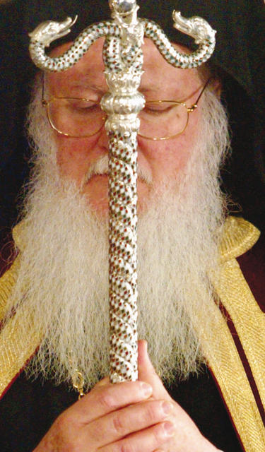 Greek Orthodox Ecumenical Patriarch Bartholomew holds his St. Andreas sceptre at the beginning of Greek Orthodox Easter mass in Aya Yorgi church in Istanbul, late April 26, 2003. Several hundreds ethnic Greeks and worshippers from Greece have attended the mass in Istanbul.   REUTERS/Fatih Saribas --- Image by © Reuters/CORBIS